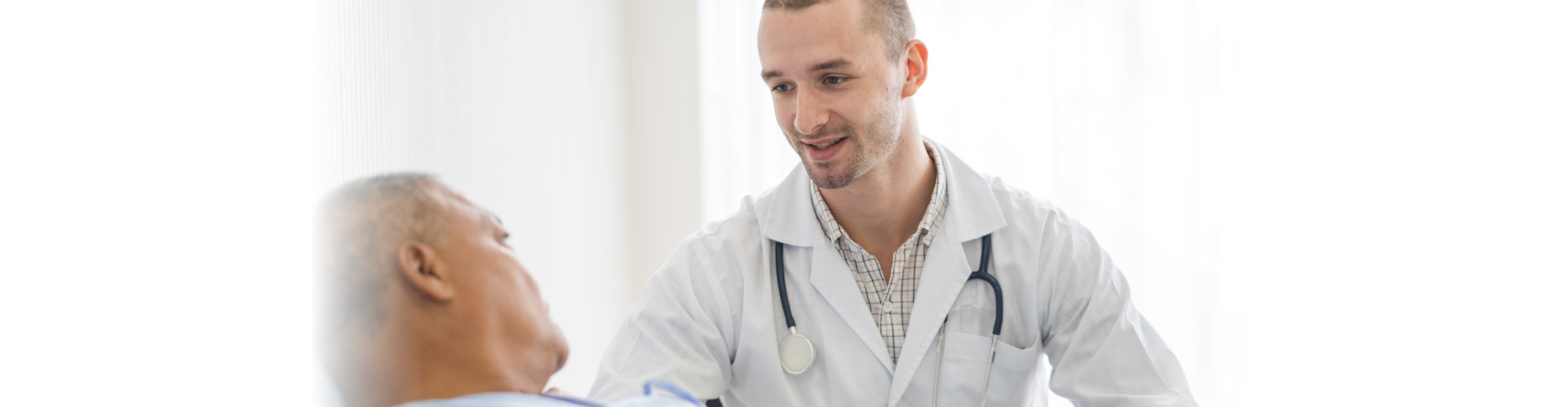 male doctor checking up on senior